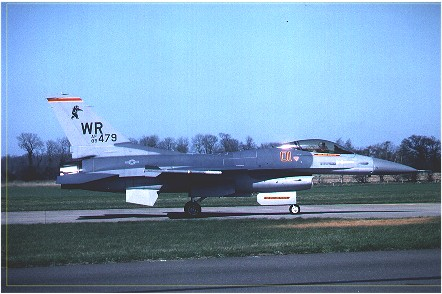 F-16C (85-0479/01) 527th TFTAS/81st TFW commander's aircraft taxis out for take off. Russian Bear marking on fin. Bentwaters November 1989.